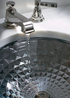 """""""Bold"""" is an understatement when it comes to this @kohlerco #sink. Reminiscent of fine jewels, this spun-glass basin adds shimmer and shine to bring any #bath or powder room to life."""