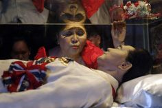 Jul. 2, 2014. Former first lady Imelda Marcos kisses the glass coffin of her husband, late president Ferdinand Marcos, who remains unburied since his death in 1989, during her 85th birthday celebration in Ferdinand Marcos' hometown of Batac, Ilocos Norte province, in northern Philippines.