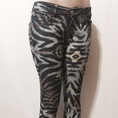 "Romeo & Juliet Couture Animal Printed Skinnies Fun and fabulous jeans! Classic 5 pocket style. Low waist, super soft . 73%cotton, 25% poly, 2% spandex. Machine washable 30"" inseam 8"" rise 10"" opening Romeo & Juliet Couture Jeans Skinny"
