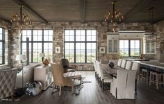 A Rustic Retreat Near the Rockies | Interior Design by Duet Design Group | Photography by David Lauer | Modern Sanctuary | Family Room | Contemporary Family Room | Rustic Family Room | Windows | Modern Windows | Lighting | Seating | Great Room | Rustic Great Room | Contemporary Great Room | Dining Space | Rustic Dining Space