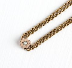 Lovely long and luxurious double linked pocket watch chain / necklace, circa 1900. The charming piece contains a slide chain which is embellished with one seed pearl, in an etched star design. The starburst charm stays in place well, but can move when it is pushed on. This piece of jewelry looks great worn as a necklace or can be used as a pocket watch chain. It secures with a swivel clip closure. Classic piece of antique Victorian era jewelry! ERA - Circa 1900, Victorian / Edwardian Era…