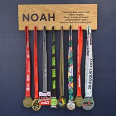 Our personalised medal hanging hook board is a great gift for the sports enthusiast which you can personalise with your name and any quote.  Are all of your medals currently tucked away in a cupboard somewhere? Well this is a perfect way to display all of your achievements in one place.  Proudly show off your running, football, swimming and cycling medals using this modern and contemporary display board.