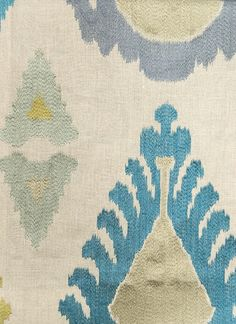 Exuberance Embroidered Fabric Embroidered linen fabric with Ikat design in Teal and Steel Grey. Suitable for Curtains and light domestic uph...
