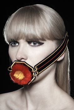 """""""Strap""""_  Digitally embroidered leather strap with lambs wool pom-pom. Can be worn on face or waist.   Photography by Alyssa Boni #face #jewellery #portrait #leather #embroidery #statement #belt #mouth #pompom #wool #fluffy"""