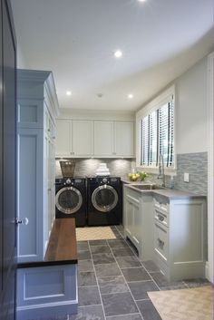 I love the home that God has given to me, but if I could build one of my own design, it would definitely include a laundry/mudroom like this.  :-)