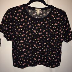 NWOTForever 21 floral crop top Brand new, never worn!!  Black with cute little pink flowers and an accent pocket. Forever 21 Tops Crop Tops