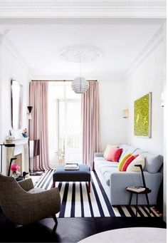 great mix of feminine and masculine   - love the pale pink curtain panels