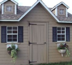 antique wall sinks find a new life as window boxes on a garden shed
