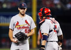 St. Louis Cardinals' Michael Wacha (52) gets a visit from catcher Yadier Molina, as Wacha gets into trouble with the Arizona Diamondbacks, giving up three runs during the first inning of a baseball game Friday, Sept. 26, 2014, in Phoenix. (AP Photo/Ross D. Franklin)