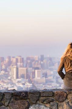 Woman on Rock Platform Viewing City