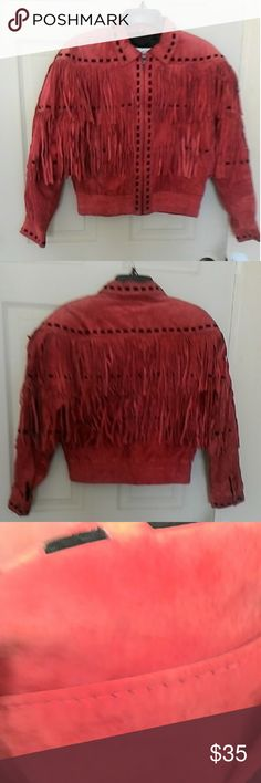 """Vintage m Julian suede fringe jacket Elastic ribbed waist& cuffs. Bust approx 35/36"""".  Waist 31"""".  From top of shoulder to bottom hem 21"""" long. 2 front slip pockets. Slight discoloration at shoulders & collar which in my opinion adds character to a vintage piece. Would look great with some skinny jeans. Color: rusty rose. No PayPal,trades,Holds or modeling  . Jackets & Coats"""
