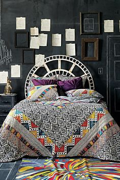 Black and white bed spread with a splash of color.