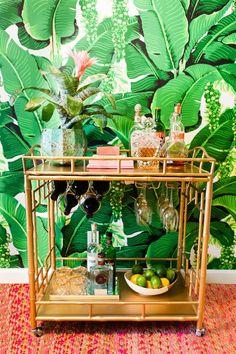 Gold Society Social bar cart against tropical leaf wallpaper Bar Cart Styling, Bar Cart Decor, Tiki Bar Decor, Tropical Bar Carts, Social Bar, Gold Bar Cart, Estilo Tropical, Deco Boheme, Tiki Room