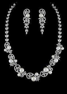 Bridal Jewelry Stunning Pearl and CZ Drop Wedding Jewelry Set in Silver plating. - Stunning Pearl and CZ Drop Wedding Jewelry Set in Silver plating. Rustic Wedding Jewelry, Wedding Jewelry Sets, Pearl And Diamond Necklace, Pearl Necklace Wedding, Bridesmaid Jewelry Sets, Custom Jewelry, Luxury Jewelry, Jewelry Stores, Jewellery Shops