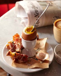 """buvette's """"soft-boiled egg with prosciutto-wrapped, Parmesan-spiked soldiers"""" = HEAVEN ON A PLATE."""