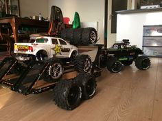 Custom Traxxas summit w my newly designed trailer and customs e Maxx on board..