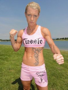 """The new women's empowerment video """"Woman's World"""" finds the successful 67 year-old shape shifting into women of various ages, races and. Top Ten, New Woman, Mma, Cool Tattoos, Bikinis, Swimwear, Champion, Japanese, World"""