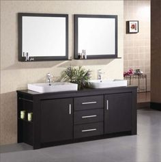contemporary cabinets and sinks.  Love the two framed mirros