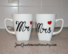 This listing is for two coffee cups: Mr and Mrs with a heart on each.  The mugs shown are Better Homes and Garden square porcelain mug and