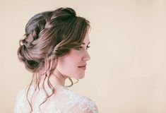 Braid bun for wedding hairstyle | How to Throw the Perfect Summer Wedding | http://www.bridestory.com/blog/how-to-throw-the-perfect-summer-wedding