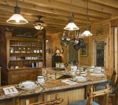 Marble and composite counter tops blend well with the rustic elegance of a log home. Another trend is to hang those cast iron and stainless steel pots and pans. The solid construction of a log home means you'll never have to hunt for a framing stud to hold the weight.