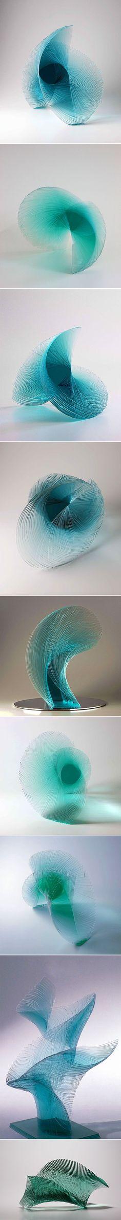Artist Niyoko Ikuta uses layers of laminated sheet glass to create spiraling geometric sculptures.