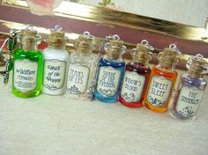 """Set of seven (7) 2ml glass bottle necklaces, all inspired by the George R.R. Martin novel series """"A Song of Ice and Fire"""" (upon which """"Game of Thrones"""" is based).  Set includes one each of the following:  - Milk of the Poppy - The Strangler - Shade of the Evening - Sweetsleep - Tears of Lys - Widow's Blood - Wildfire"""