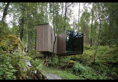 Juvet Landscape Hotel | Supported on slim columns and dodging existing vegetation, cabins touch the ground lightly and defer to the landscape