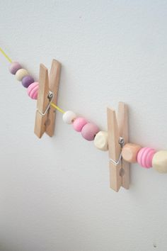 idea for hanging art. Cute for a play room, i would paint the clothes pins too