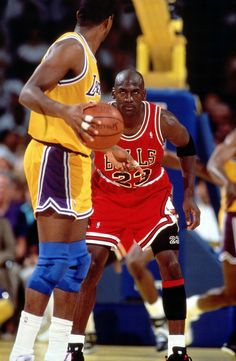 Michael Jordan stares down Magic Johnson in Game 5 of the '91 NBA Finals. The Bulls won the game 108-101 and the series 4-1 to bring the franchise its first championship.