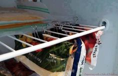 Efficiently use freezer space with binder clips.  As seen on Organizing With a Side of Fabulous Clips can secure bags underneath a wire rack, and quell digging through piles of frozen food.