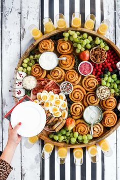 Dec 2019 - Epic Christmas Cinnamon Roll Board —Here's a fun way to celebrate breakfast or brunch with your family and friends! Serve an Epic Christmas Cinnamon Roll Board. This post is sponsored by Canary & King! Christmas Brunch, Christmas Breakfast, Christmas Dinners, Christmas Morning, Breakfast Platter, Breakfast Buffet, Breakfast Casserole, Party Food Platters, Food Trays