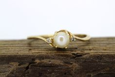 Dainty Pearl Ring Vintage by FergusonsFineJewelry I love pearls. Pearls with diamonds even better.