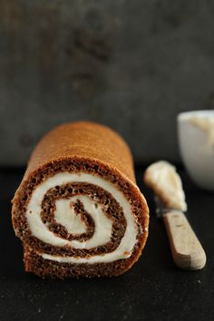 Pumpkin Roll by My Baking Addiction. A moist, spiced pumpkin cake rolled with a silky cream cheese filling that will impress your holiday guests.