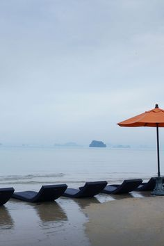 Beach in Krabi with views of the limestone formations in the distance