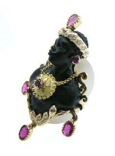 Bust ebony  Total Size 6 cm ring  Mounted in 18 kt yellow gold 19gr.  Rubies 3.84 kt  Diamonds kt0, 26 - Dogale Jewellery Venice Italia