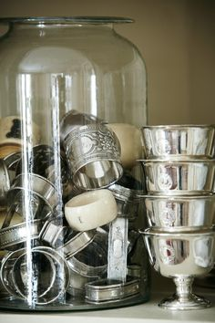 collection of silver napkin rings, set of hotel silver bowls, large blown glass jar