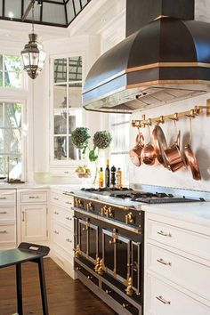 The La Cornue range and matching hood make a strong statement in the kitchen.