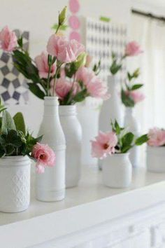 Spray paint old bottles and jars white and add silk or real flowers for easy, pretty decor