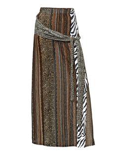 Rassiger Animal-Print und efffektvolle Wickel-Optik, eine tolle Kombination! Legere A-Linie mit Gummizugbund und breiten Bindbändern. Länge ca. 96 cm. 90% Viskose, 10% Elasthan. Waschbar....
