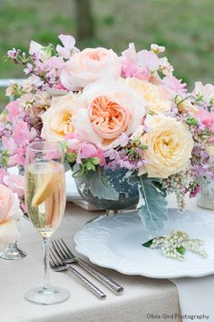 Beautiful and airy; hand-opened roses, sweet peas, cherry blossoms and old-fashioned roses with dusty miller.  So pretty!