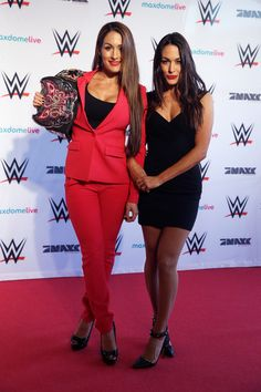 Nikki Bella Photos - Brie Bella and Nikki Bella (L) are pictured at the red carpet prior to the WWE Live event at World on April 2015 in Hamburg, Germany. Nikki Bella Photos, Nikki And Brie Bella, Daniel Bryan, Brie Bella Wwe, Bella Sisters, Trisha Photos, Becky Wwe, Wwe Sasha Banks, Nicole Garcia