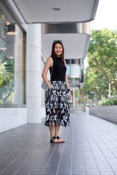 SHENTONISTA: A Good Story. Maggie, Fashion. Skirt from Self Portrait, Bag from Bao Bao Issey Miyake, Shoes from Acne Studios, Bracelet from Balenciaga, Sunglasses from Ray Ban. #shentonista #theuniform #singapore #fashion #streetystyle #style #ootd #sgootd #ootdsg #wiwt #popular #people #male #female #womenswear #menswear #sgstyle #cbd #SelfPortrait #BaoBaoIsseyMiyake #AcneStudios #Balenciaga #RayBan