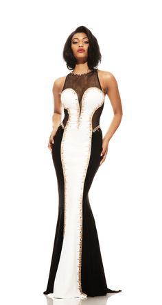 A graphic and dramatic Johnathan Kayne signature piece combining black jersey, white neoprene jersey, and rose gold beading to create this elegant color blocked gown. The keyhole back and small train