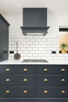 Pantry Blue Shaker draws with Bella Brass Handles and Carrara marble worktops