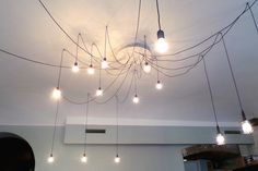 Pritličje ~ Peach Black / The spider #lights are really #trending right now. Let's see how this design handles the hand of time... #interior #industrial #design