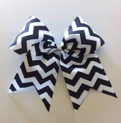 Hey, I found this really awesome Etsy listing at http://www.etsy.com/listing/161681977/black-and-white-chevron-cheer-bow
