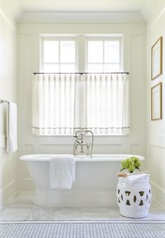 Chic Bathroom Nook Is Clad In Decorative Wall Moldings Filled With A Roll Top Tub And Vintage Hand Held Filler As Well White Rope Stool Placed