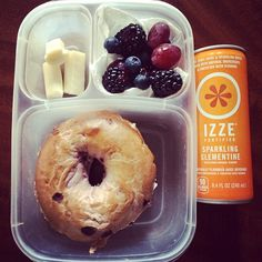 Blueberry bagel with organic cream cheese. Fruit salad with blackberries, blueberries, & grapes. Cheese stick. Sparkling fruit juice Izze. | via cleaneatingallergyfree - Instagram