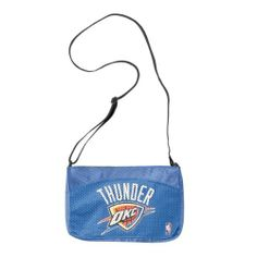 NBA Oklahoma City Thunder Jersey Mini Purse by Little Earth. $20.00. Two Inner Pouch Pockets keep Belongings Safe. Zipper Closure. 100% Polyester. Mini Purse made with Authentic Jersey Material. Screen Print of Favorite Team Logo and Name. This hip Mini-Jersey Purse takes the look of an authentic jersey and turns it into a fashionable handbag.  Displays screen print of favorite Team Logo and Name.  Mini Jersey Purse has a Zipper closure and two inner patch pockets to help keep al...